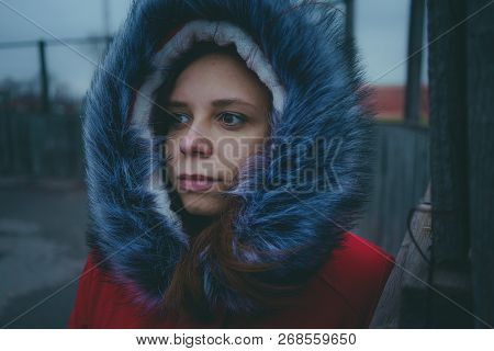 poster of Girl Posing On The Street, A Student In Street Clothes In The Winter. Street Style. Emotional Portra