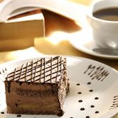 close up shot of a sliced cake and tea