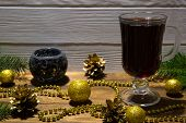 Hot Mulled Wine With Christmas Decoration, Golden Christmas Balls, Golden Beads And Golden Pine Cone poster