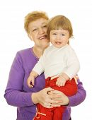 Smiling baby with her grandma isolated on white