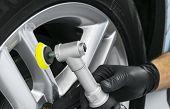Car Polish Wax Worker Hands Polishing Wheel. Buffing And Polishing Car Disk. Car Detailing. Man Hold poster
