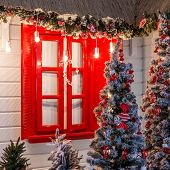 Christmas Front Door Of A Country House Background. Decorated With Lights Front Door Of A Pretty Hou poster