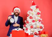 How Much Time Left. Keep Track Of Time. Time To Celebrate. Man Bearded Wear Suit And Santa Hat Hold  poster