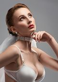 Portrait of a sensual bride with pearl necklace
