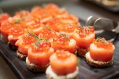 Salmon canapes, close up shot, narrow focus