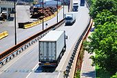 Transportation of containers by lorry