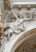 stock photo of flambeau  - medieval sculpture of a woman angel on the villa - JPG