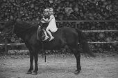 Equine Therapy, Recreation Concept. Children Sit In Rider Saddle On Animal Back. Sport, Activity, En poster