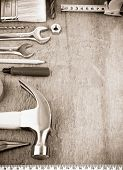 tools and instruments at wooden board on sepia