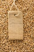 wheat grain and price tag with wood