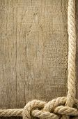 ship ropes knot on wood background texture