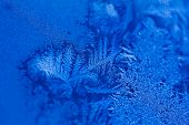 Beautiful Frosty Pattern On A Winter Window Close Up. Frozen Pattern On The Window. Frozen Water On  poster