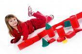 Little girl with red blocks. Studio shot