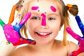pic of finger-painting  - little girl with paint over white background - JPG