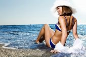 Young fashion woman in swimwear on the beach
