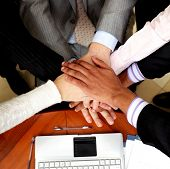 Image of business people hands on top of each other. View from above