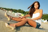 Young lovely fashionable woman at the beach
