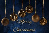 The Inscription Merry Christmas On A Dark Blue Background With Textures And Decorative Putty. Six Go poster