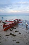 stock photo of camiguin  - outrigger banka boats at sunset on camiguin island mindanao the philippines - JPG
