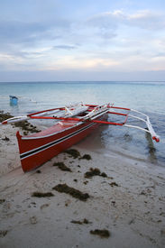 picture of camiguin  - outrigger banka boats at sunset on camiguin island mindanao the philippines - JPG