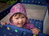 Baby Smiling In Playpen Outside