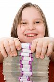 Cheerful Girl And Pile Of Money