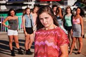image of cynicism  - Skeptical European teenager at carnival with friends - JPG