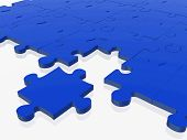 image of peculiar  - blue puzzle with one piece off the puzzle - JPG
