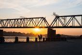 Walk At The River At Sunset