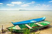 foto of boggy  - two boats and cane on the bank of lake - JPG