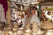Sorochinskaya Fair. Potter Sells Pottery.