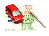 Toy Car, Pen And Money Over White. Rent, Buy Or Insurance Car Concept