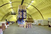 Warehouse Hangar Of Polyurethane Foam, Storage Hangar With Shelves And Goods