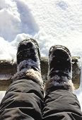 Feet In Boots In The Snow.