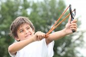 picture of eye-wink  - Boy with slingshot - JPG