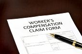 stock photo of workplace accident  - Worker compensation form for employment related injury or damage - JPG