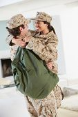 Military Couple Greeting Each Other On Home Leave