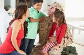 stock photo of camouflage  - Family Greeting Military Father Home On Leave - JPG
