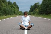 Girl Sitting On Road