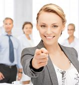 picture of attractive businesswoman pointing her finger