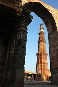 image of qutub minar  - qutub minar in delhi looking through a gate - JPG
