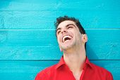 Portrait Of A Young Man In Red Shirt Laughing