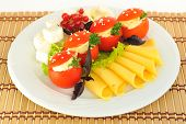 Tomatoes stuffed with cheese beautifully decorated served with cheese diced and sliced??.