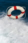 Life preserver thrown into splashing water