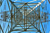pic of electricity pylon  - Steel electricity pylon on bright blue sky - JPG