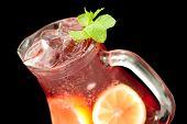 Fresh lemonade from lemon and berries closeup