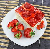 cake with fresh fruits with red jelly