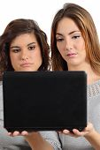 Two Teenager Girls Bored Watching A Netbook Computer