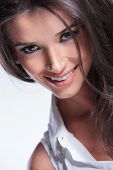 closeup picture of a young beauty woman smiling for the camera