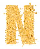 N, alphabet,Letter from Split and hulled mung beans on isolated white